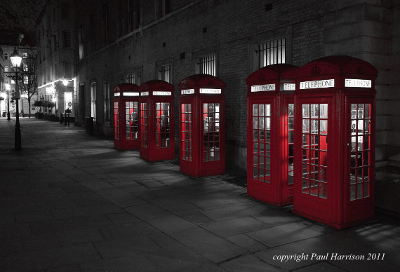 Red phone boxes at night, London