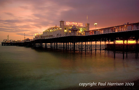 Brighton Pier illuminated at sunset